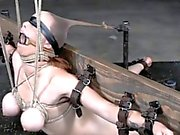 Gagged restrained busty sub slut punished