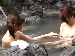 A couple of Asian hotties are naked outside and playing in