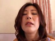 Striking Oriental wife shows off her lovely titties and her