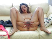 Amateur rubs her hairy pussy