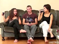 Amateur threesome on the sofa