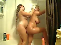 Pregnant lesbian and her friend in the shower