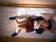 Sexy little schoolgirl is getting a sensual massage on boob