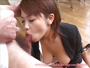 Asian brunette sucking cock