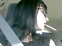 Sexy Mina smoking in the car