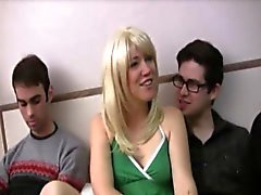 Cute amateur blonde Gwenn is on a bed with two guys Jared