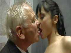 Dirty old men have some fun with a beautiful dark-haired lass