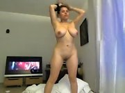 Teen busty brunette squeezes boobs and fucks on soft couch