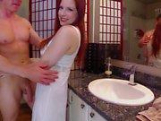 Redhead amateur MILF bangs with her lover boy in bathroom