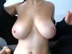 Gorgeous brunette babe with big natural boobs has a massage