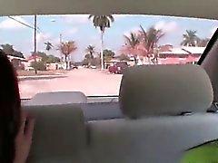 Two brunet girls sucking dick in car