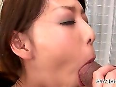 Brunette asian has her ass double fisted