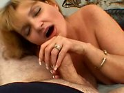 Fat blonde housewife sends her skillful hands taking a dick to climax
