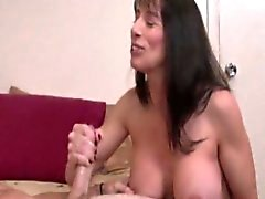 Amateur tugging milf gets jizz on her bigtits