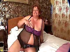 Big Mature Redhead Rubs Her Pussy And Sucks A Cock