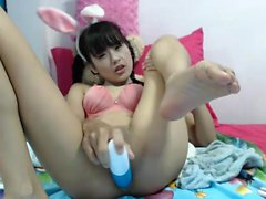 Pigtailed nympho spreads her legs and drills her slit with