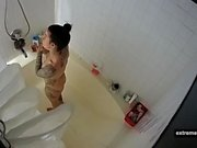 Spying my tattooed sister taking a shower