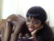 Hot ebony babe toying her pussy with a bottle