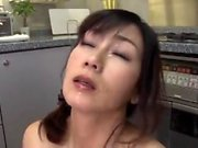 Japanese MILF in a passionate sex massage