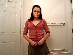 Dark haired girl in red strips in bathroom