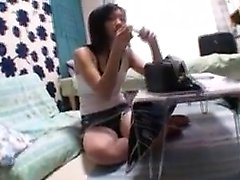 Young Asian cutie in a denim miniskirt kneels to deepthroat
