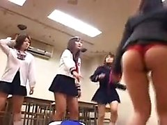 Foxy schoolgirls pull down their panties to show off their