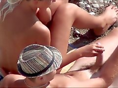 Voyeur. Girl Jerks Off guy dick on a public beach