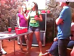 Group of college girls playing beerpong with horny guys