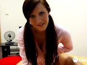 Brunette babe masturbating with red dildo
