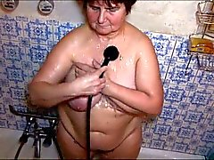 Dirty old granny plays with clit in shower
