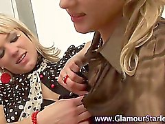 Clothed lesbians licking and fingering