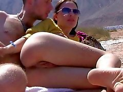 Amateur hottie tanning at the beach pussy rubbed