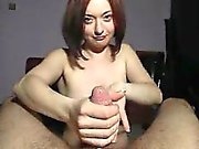 Enchanting wife with nice boobs sucks and strokes a fat coc