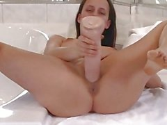Clit slit stuffed brunette amateur with huge dildo