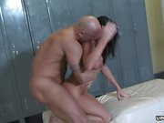 Big ass brunette's smooth cunt receives a locker room pummel