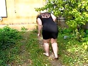 fat girl with hairy by a pussy, pissing standing in the garden