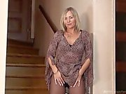 MILF in pantyhose struts her stuff