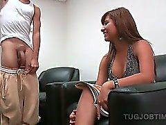 Tanned smoking hot redhead giving her best tugjob
