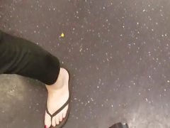 Candid pale feet red nails