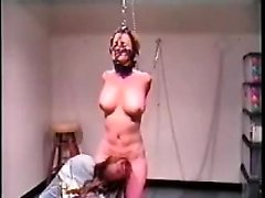 Tied up busty slave is untied just enough to bend over and get fucked