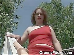 In this video, you'll find a curvy older woman masturbating