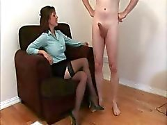 Stocking wearing milf jerks a boys cock