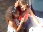 Overhead spycam shots show happy street partygoers making o