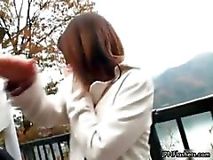 Cute shy Japanese girl flashing her tits