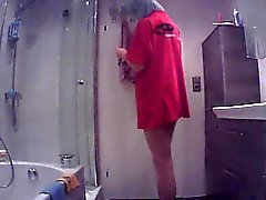 Hidden cam catches a babe getting out of the shower and dre