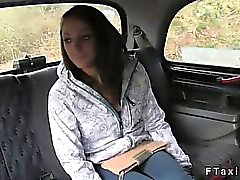 Officer and taxi driver fuck brunette on backseat in public