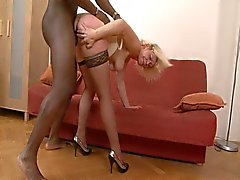 Lustful granny in stockings gulping for monstrous black cock