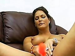 Milf Jolie moans as she masturbates her shaved wet pussy