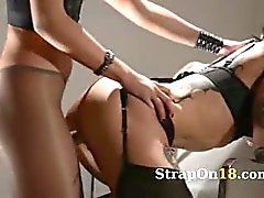 Tatto lezzies enjoying sex with strap on